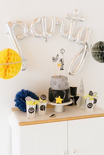 Sideboard decorated with space-themed birthday party