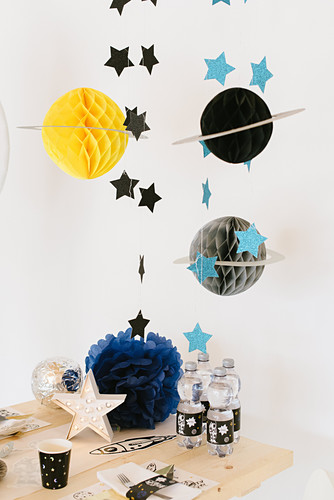 Honeycomb paper planets for space-themed birthday party