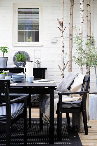 Black garden furniture on Scandinavian-style terrace