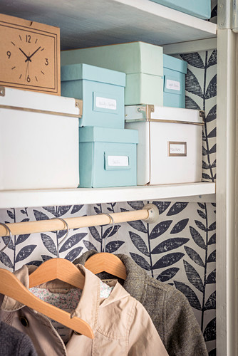 Storage boxes in DIY fitted wardrobe
