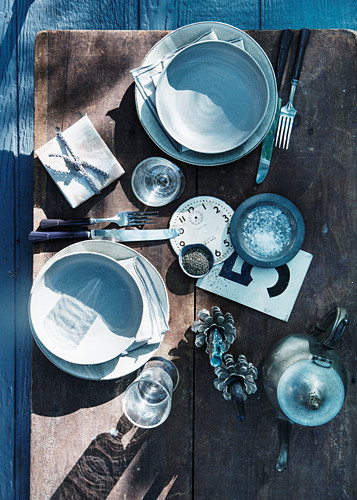 Top view of rustic place setting with knick-knacks