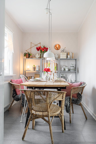 Festively set dining table in narrow room