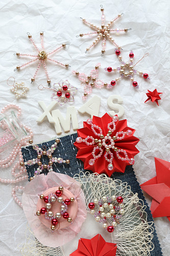 Romantic Christmas arrangement of bead and paper stars and snowflakes