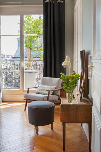 Vintage furniture in bedroom of Parisian period building