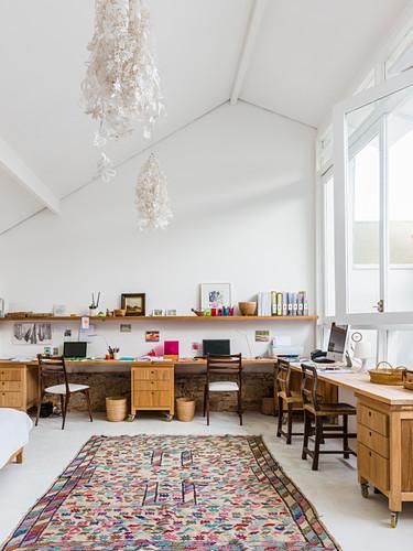 Multiple workstations on long L-shaped desk