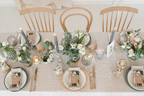 Table festively set for wedding in natural shades
