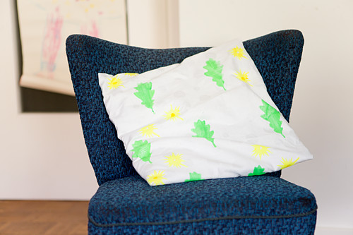 Cushion cover printed with yellow flowers and green leaves (DIY foam rubber stamp)