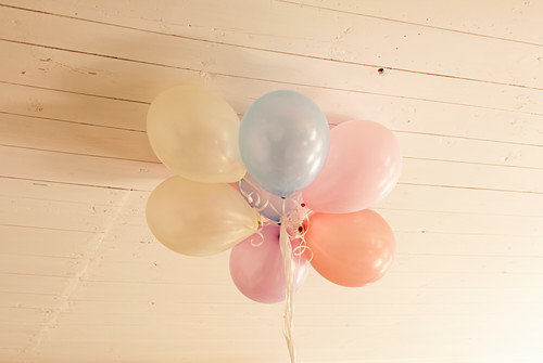 Balloons under wooden ceiling