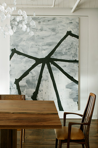 Abstract monochrome painting behind dining table