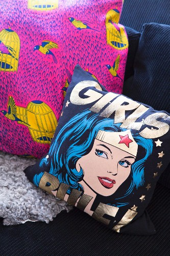 Scatter cushions with comic-book motif and bird motif