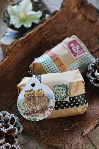 Gifts wrapped using unusual washi tapes, gift tags and stamps