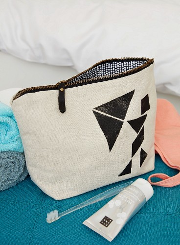 A homemade cosmetic bag with tangram shapes