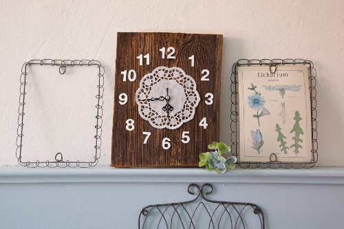Clock made from old piece of wood, numbers and doily