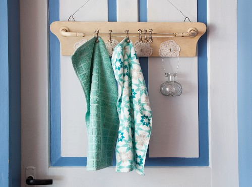 Old towel rack decorated with doilies