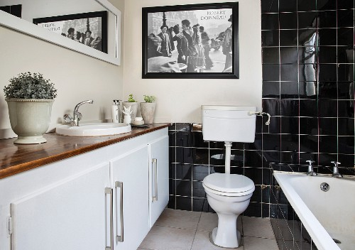 Black tiles and long washstand in bathroom