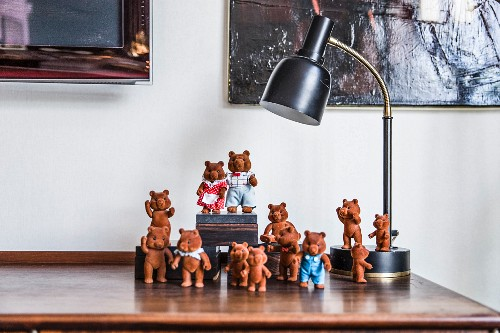 Collection of bear figurines under table lamp