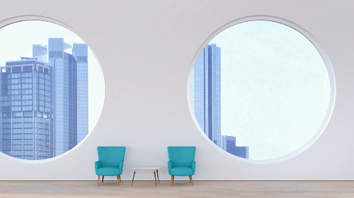 Two retro armchairs with view of skyline seen through round windows; 3D rendering