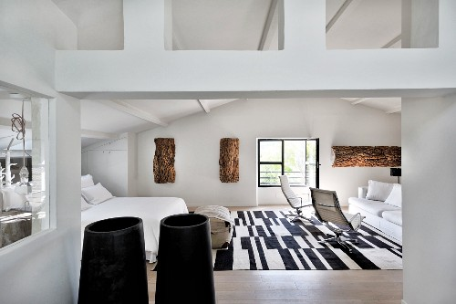 Lounge area and black and white rug in attic bedroom