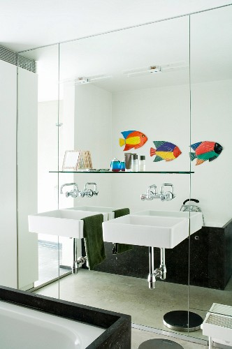 Mirrored wall and twin square sinks in bathroom