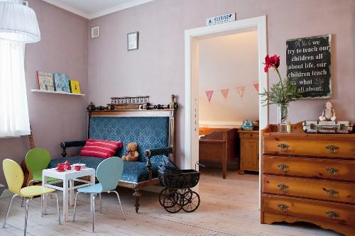 Antique couch, vintage dolls' pram and contemporary children's furniture