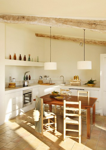 Dining area in rustic kitchen without wall units
