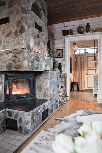 Stone-clad log-burning stove in living room