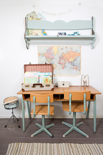 Old chairs at school desk and vintage-style accessories in child's bedroom