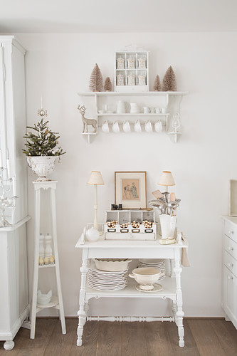 Shelves and vintage decorations in white shabby-chic kitchen