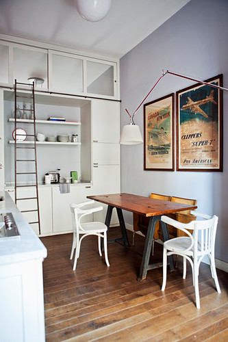 Kitchen-dining room with floor-to-ceiling fitted cupboards in small apartment
