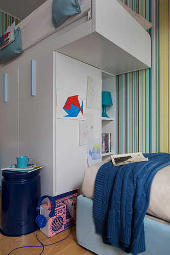 Loft bed above storage cupboards in sibling's bedroom