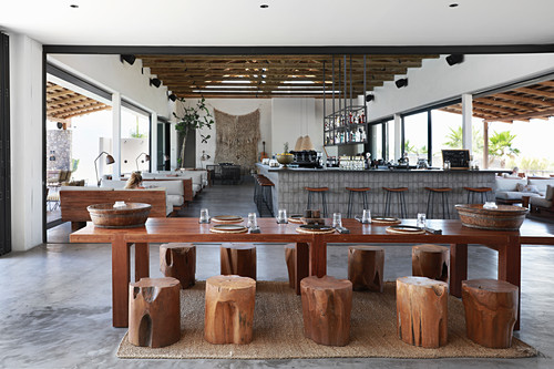 Set table with tree-stump stools in hotel lobby