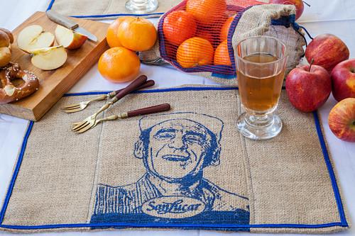 Decorative linen place mat with blue printed motif