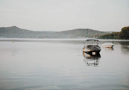 Two small motor boats on lake