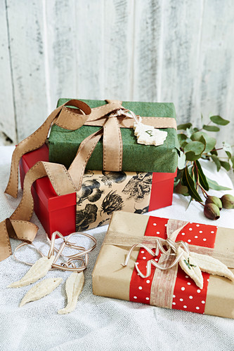 Christmas wrapped gifts with ribbons and tags