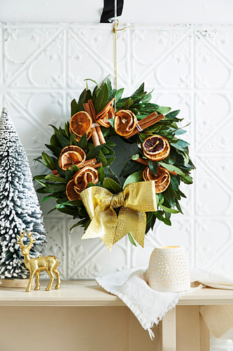 Christmas wreath of laurel leaves, cinnamon and slices of orange