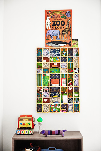 Display case with colourful back wall in child's bedroom