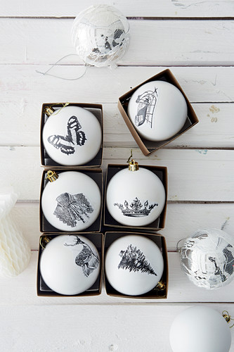 Christmas baubles hand-decorated with black-and-white decoupage motifs