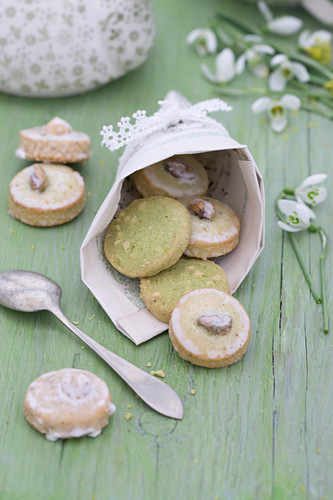 Pistachio biscuits in cone handmade from sheet music with lace trim