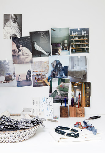 Magazine clippings on wall above desk
