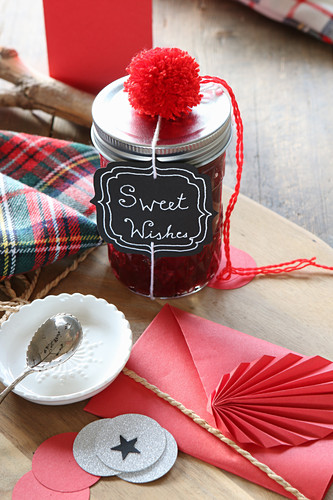 Culinary gift in screw-top jar with label and red decorations