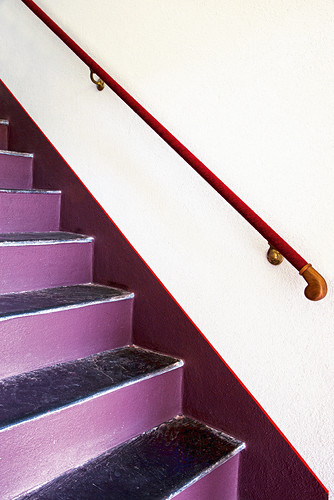 Purple stairs with handrail