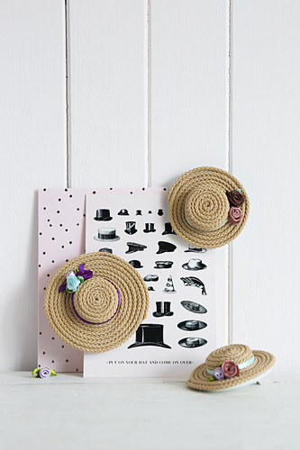 Handmade hat-shaped hair clips made from cord and small flower ornaments