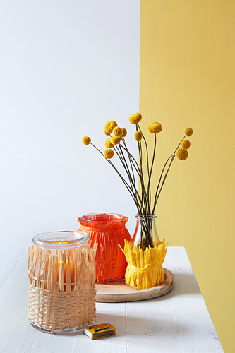 Vase and lanterns decorated with raffia