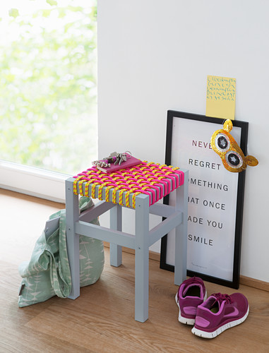 A stool with a homemade woven rope seat