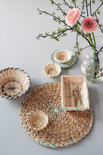 A placemat and a wicker basket decorated with wool