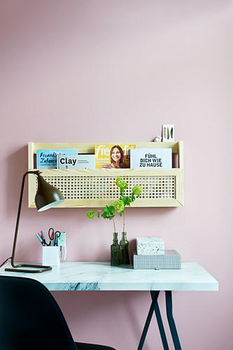 A DIY wall shelf made of wood and wickerwork