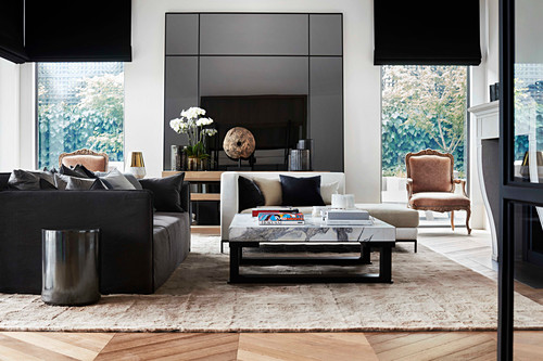 Elegant living room with sofa, daybed and coffee table with marble top