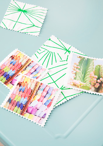 Memory card game made from holiday photos on green-and-white fabric backing