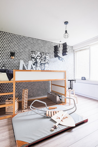 Child's bedroom in black, white and grey with graphic wallpaper pattern