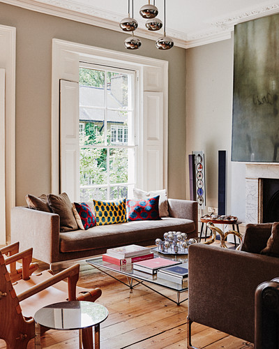 Modern furnishings in living room of period apartment with stucco ceiling